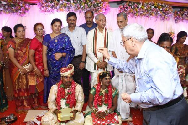 Dr GS Rao blessing couple at wedding