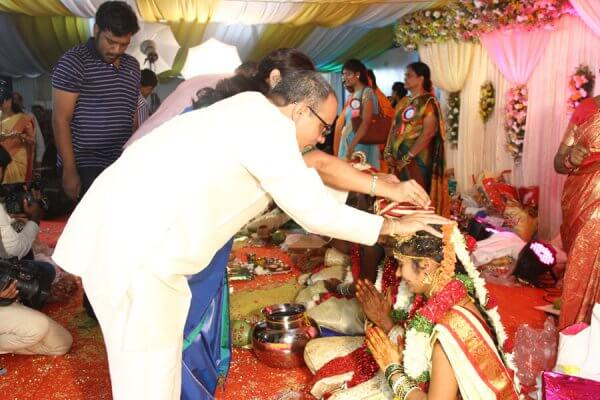 G Devender Rao blessing couple at wedding
